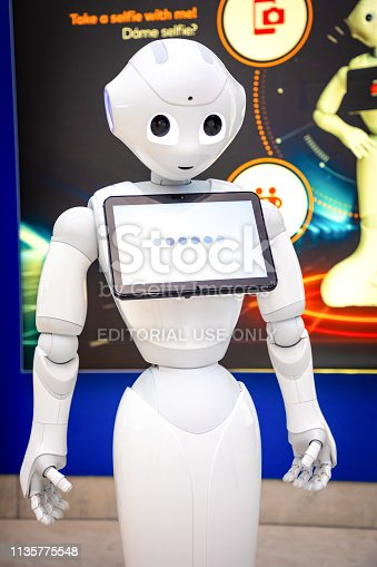 istock The Robot consultant with digital tablet in Prague airport. The robot is making multi-lingual announcement 1135775548