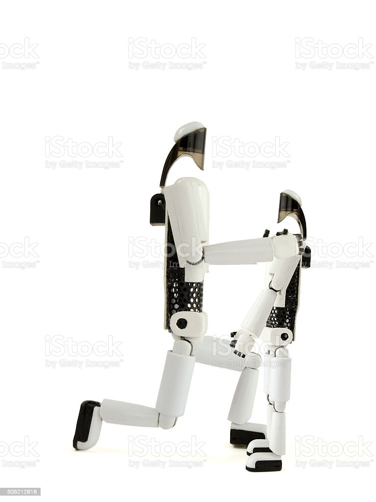 the robot talks to the small robot stock photo