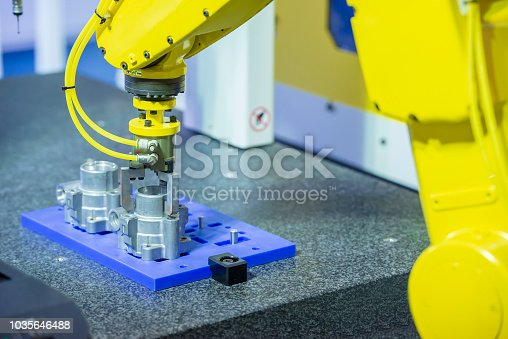 istock The robotic arm catch the aluminum part for manufacturing   process . 1035646488