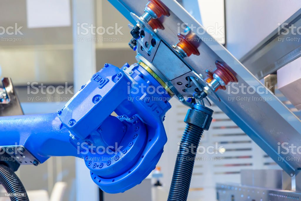 The robotic arm for metal forming process. stock photo
