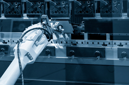 The robotic arm operation at hydraulic bending machine. The hi technology sheet metal forming process by robotic system.