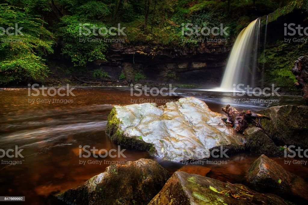 The rock at Sgwd Gwladus waterfall stock photo