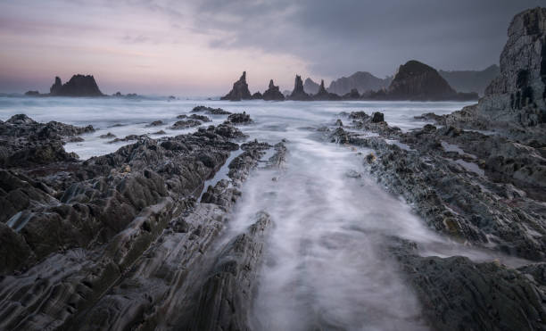 The rock formations of Playa Gueirua in Asturias, Northern Spain stock photo