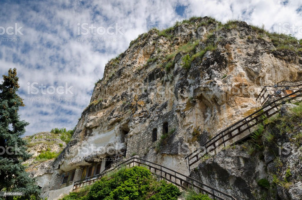 The rock monastery St Dimitrii of Basarbovo stock photo