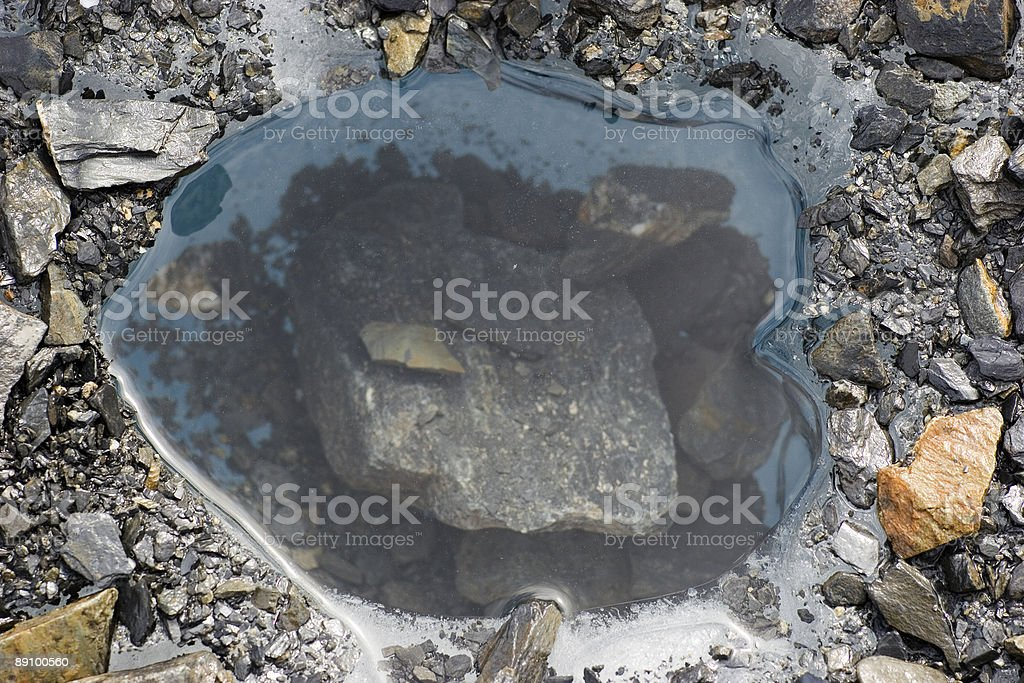 The rock that created a civaty in ice royalty-free stock photo
