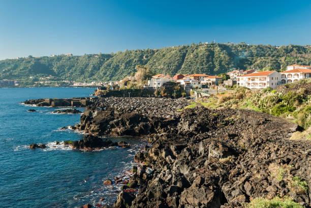 The rocky coastline in Santa Tecla, a small village near Acireale stock photo