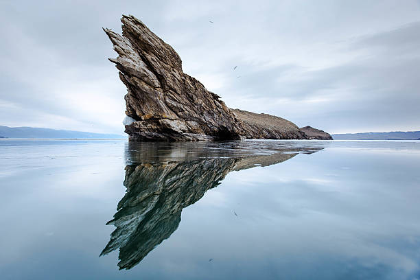 The rocky promontory on the island stock photo