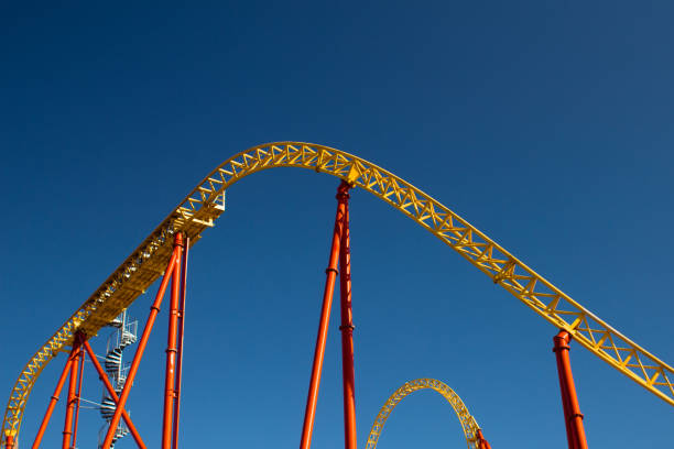 the roller coaster attraction - roller coaster stock pictures, royalty-free photos & images