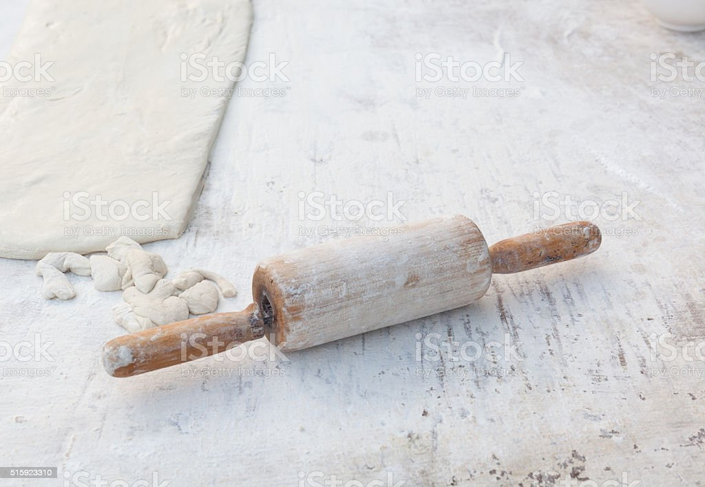 the rolling pin on the powder wood background stock photo