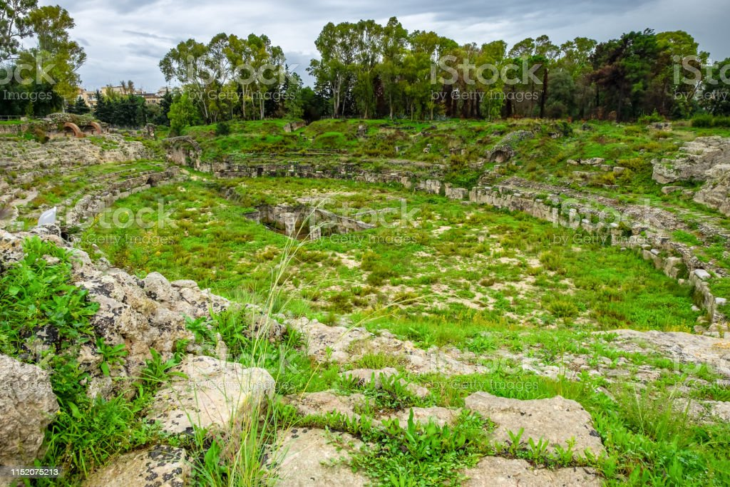 The Roman arena for gladiators fights of Syracuse, ruins in...