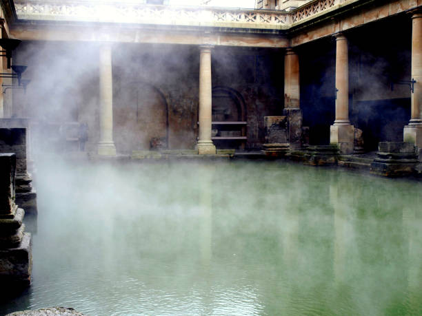 The Roman Bath, Bath, Somerset, UK. Bath, Somerset, UK. December 15, 2009.  Steam rising from the hot water of the Roman bath at Bath in Somerset, UK. roman baths england stock pictures, royalty-free photos & images