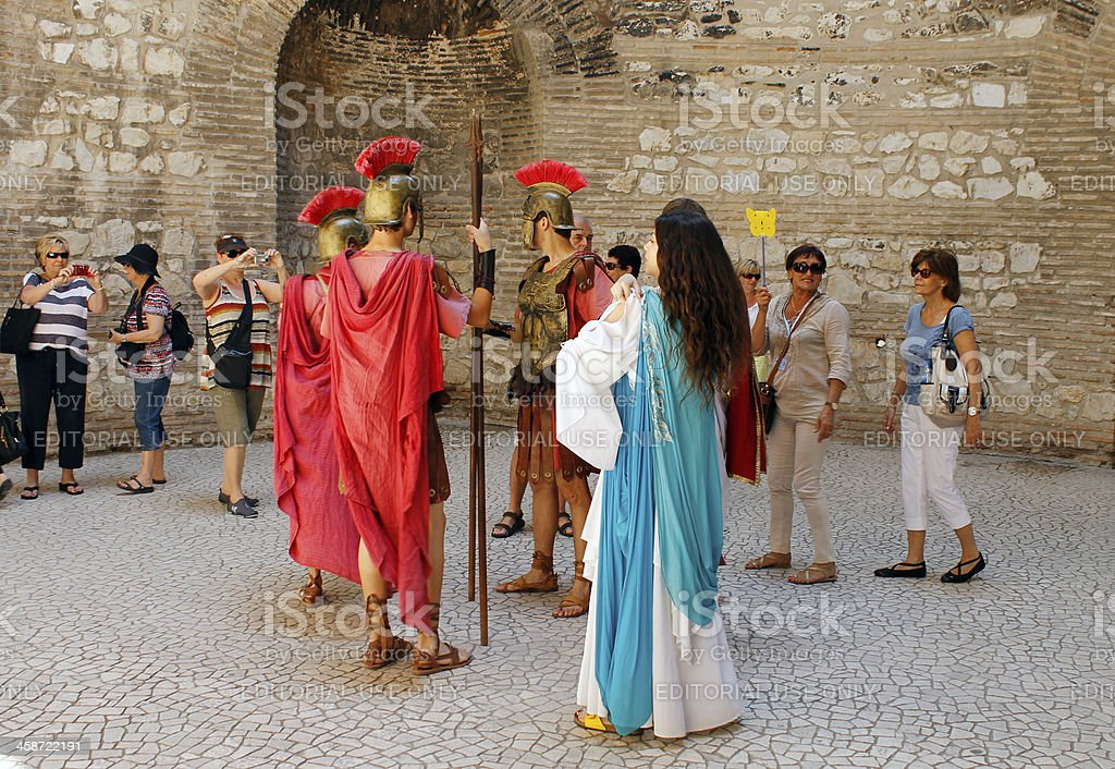 The Roman centurions in company of tourists stock photo