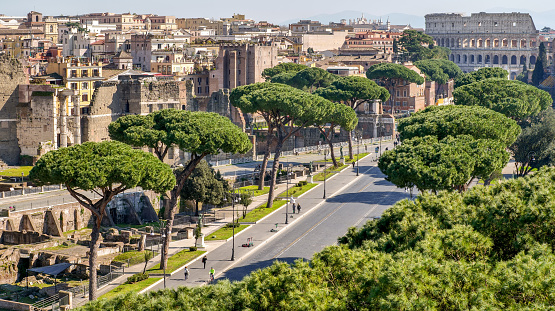 Rome, Italy, February 26 -- The Imperial Forum boulevard, the Roman Forum Archaeological Park and the imposing Coliseum in an image take from the Altare della Patria viewpoint. The Roman Forum its one of the largest archaeological areas in the world. Image in High Definition format.