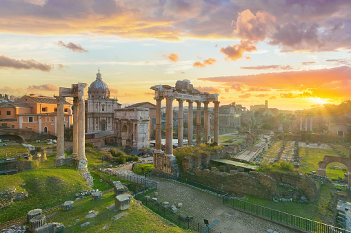 Left to right: Arch of Septimius Severus, the ruins of Temple of Saturn, the remains of the colonnade of Basilica Julia, the ruins of Temple of Castor and Pollux (the ruin with three columns). Arch of Titus is visible in the distance.