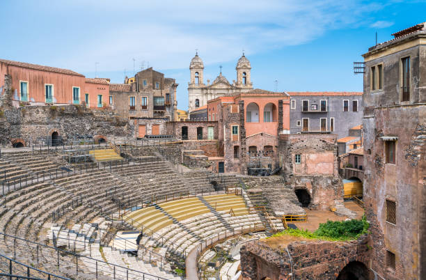The roman theater in Catania, with the Church of St. Francis of Assisi on the background. Sicily. Italy. The roman theater in Catania, with the Church of St. Francis of Assisi on the background. Sicily. Italy. catania stock pictures, royalty-free photos & images