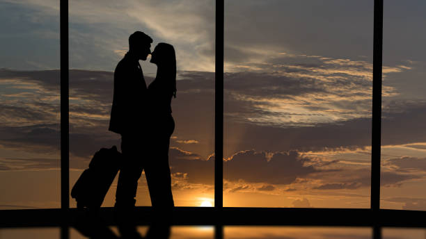 the romantic couple standing in the big hall with a scenery sky view - man look sky scraper foto e immagini stock