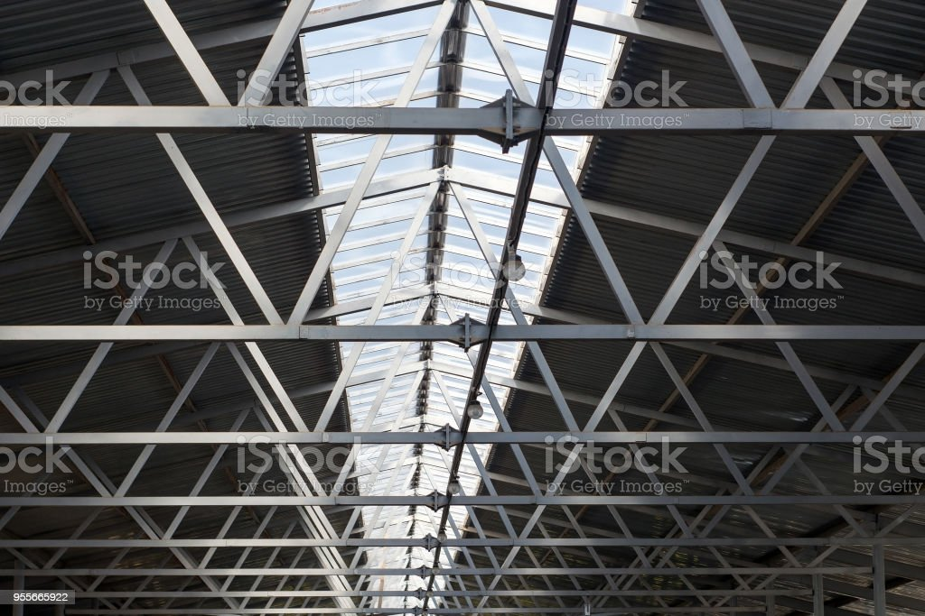 the roof design of a modern barn with a solid window stock photo