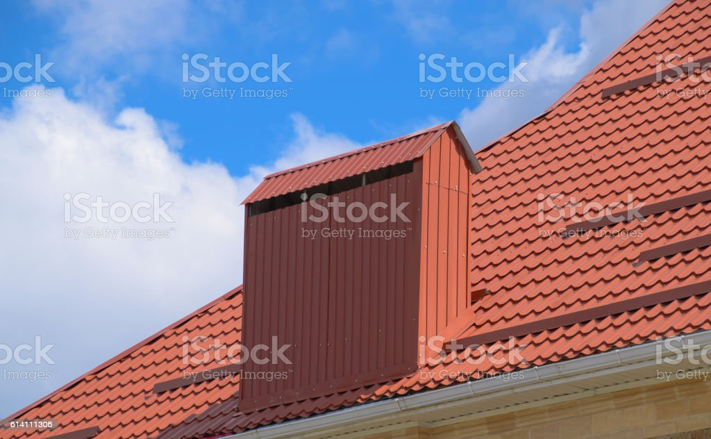 The roof of corrugated sheet red orange stock photo
