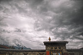 the roof top entrance of  National Memorial Chorten, Thimphu, Bhutan during gloomy cloudy day