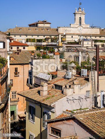 The rooftops of the iconic roman Pantheon quarter, in the heart of Rome. At right the bell and clock tower of the Montecitorio Palace, site of the Italian Parliament (House of Representatives). Image in High Definition Format.
