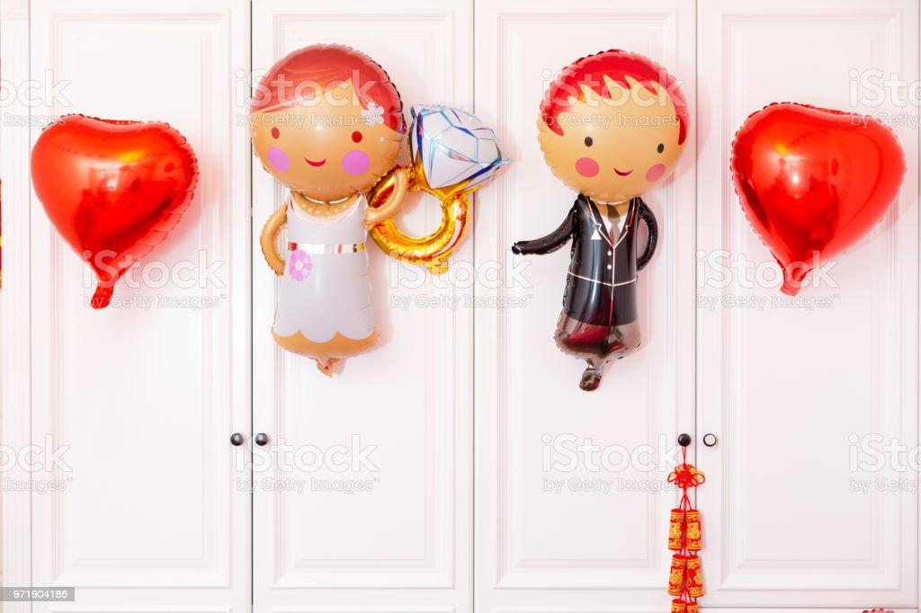 The room layout of Chinese newlyweds, many strange shaped balloons. stock photo