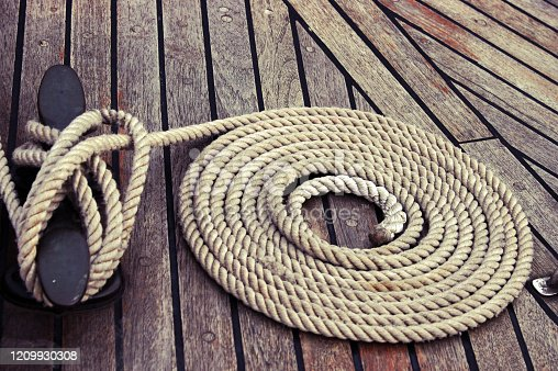 the rope is neatly folded on the ship's deck
