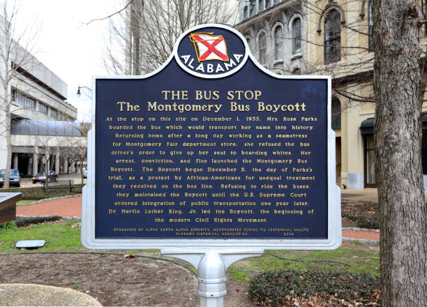 The Rosa Parks Bus Stop Montgomery, Alabama, USA - February 4, 2019: A sign marking the location of Rosa Parks' bus stop in Montgomery, Alabama. Rosa Parks is a well-known activist in the American civil rights movement. civil rights stock pictures, royalty-free photos & images