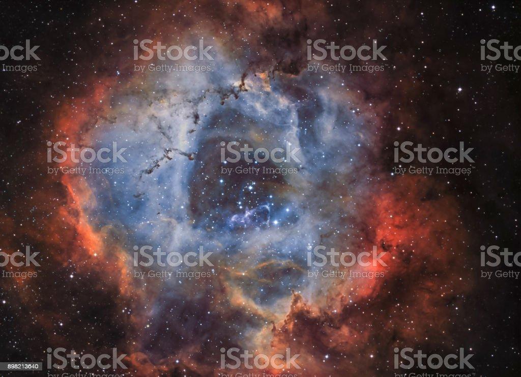 The Rosette Nebula (NGC 2244) in narrow band light stock photo