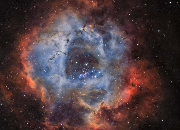 the rosette nebula (ngc 2244) in narrow band light - big bang foto e immagini stock