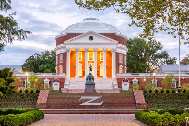 The Rotunda at the University of Virginia at dusk with Thomas Jefferson Statue in the foreground Charlottesville, USA - September 16, 2017: The Rotunda at the University of Virginia at dusk with Thomas Jefferson Statue in the foreground charlottesville stock pictures, royalty-free photos & images