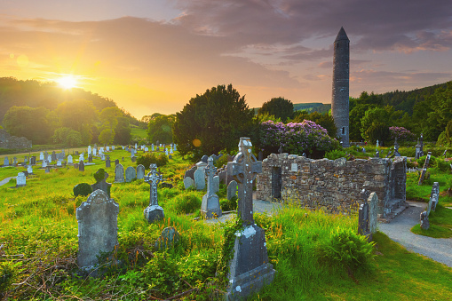 The round tower and the cemetery at the Glendalough monastic site in Country Wicklow, Ireland