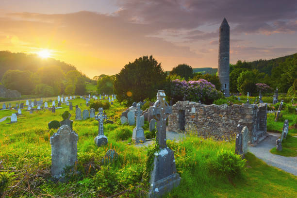 The round tower and the cemetery at the Glendalough monastic site in Country Wicklow, Ireland stock photo