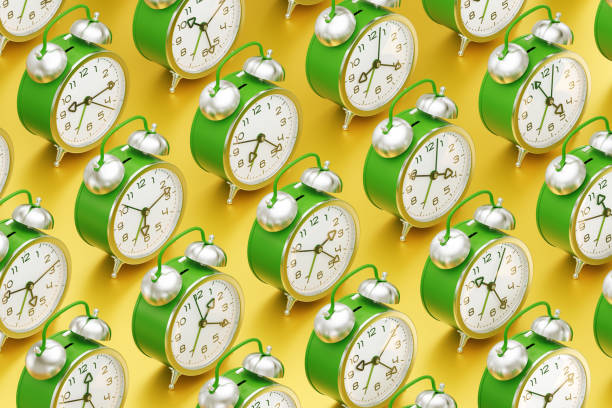 The Routine of a Time Arranged to rows vintage alarm clocks which are standing one after another on yellow reflective surface. 3D rendering graphics. samenwerking stock pictures, royalty-free photos & images