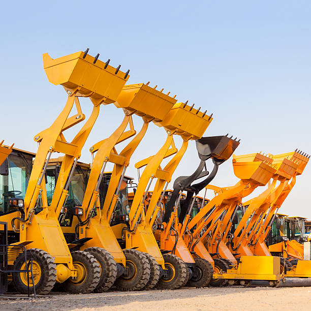 The row of heavy construction excavator machine  against blue sk stock photo
