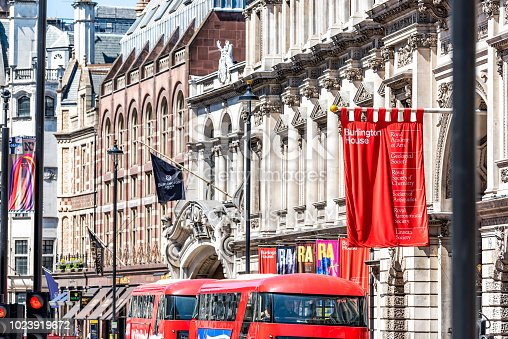 1125782554 istock photo The Royal Academy of Arts institution at Burlington House on Piccadilly Circus with Arcade, summer exhibitions banners advertising colorful on sunny summer day 1023919672