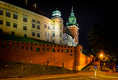 Krakow, Poland - August 22, 2017:The Royal Castle on Wawel Hill by night in the city of Krakow in Poland