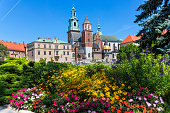 Krakow, Poland - August 13, 2018:The Royal Castle with Wawel Cathedral on Wawel Hill in the city of Krakow in Poland. Wawel Royal Castle is inscribed on the UNESCO World Heritage List
