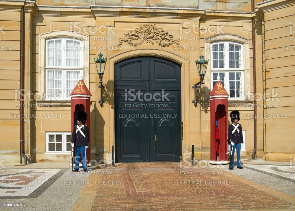 The Royal Guards in front of Amalienborg Palace in Copenhagen. stock photo