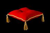 A red velvet tufted presentation pillow