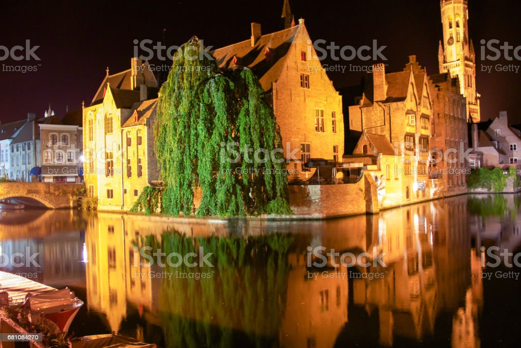 The Rozenhoedkaai canal in Bruges with the Belfry in the background, Belgium royalty-free stock photo