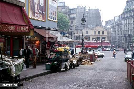 Paris, France, Europa, May 29, 1974. Sales carts roadside, small shops, pedestrian and road construction - Street Scene in Paris. The Rue Lepic facing the Place Blanche.