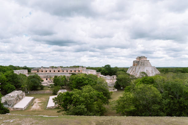 the ruined nunnery quadrangle and the pyramid of magician, uxmal, yucata, mexico - uxmal stock photos and pictures