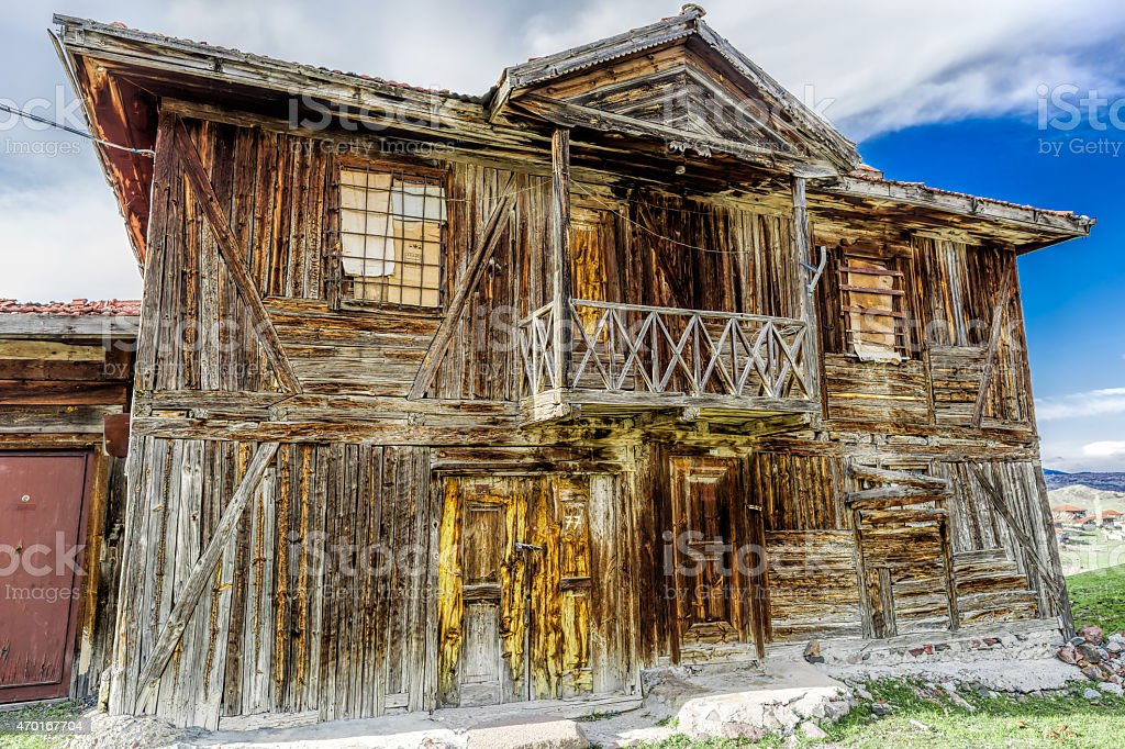 the ruins of a wooden house stock photo
