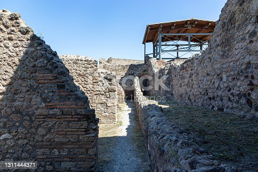 The ruins of the ancient city of Pompeii, which died in the 1st century AD as a result of the eruption of Mount Vesuvius. Summer sunny day. Pompeii, Campania, Italy.