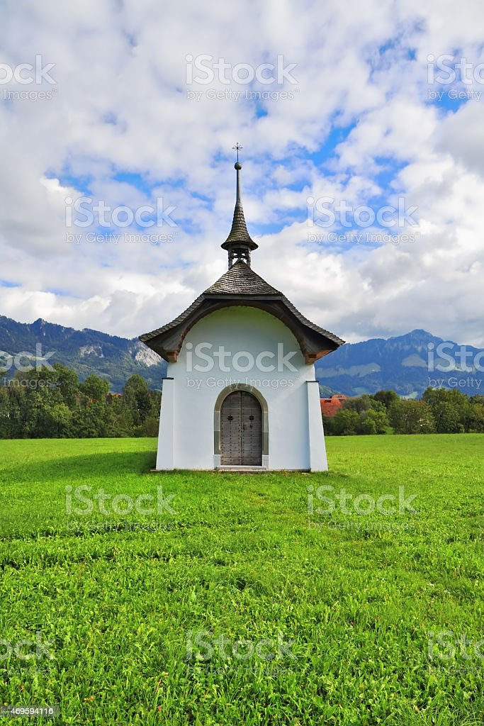 The rural chapel crowned picturesque cross stock photo