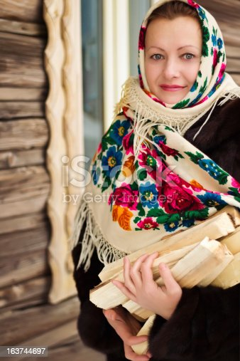 istock The Russian woman carries firewood 163744697