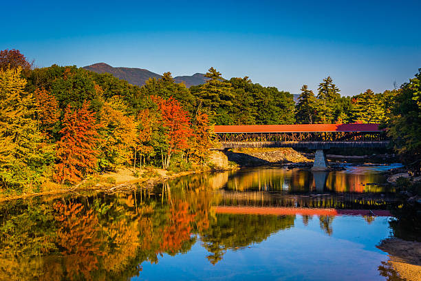 The Saco River Covered Bridge in Conway, New Hampshire. stock photo