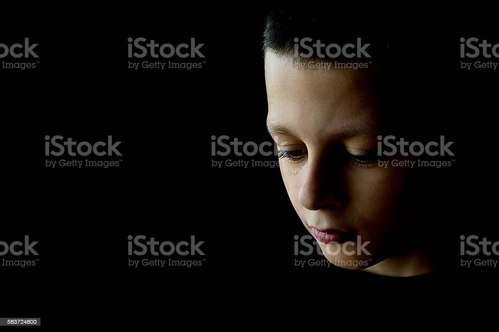 The Sad Boy With Tears in His Eye stock photo