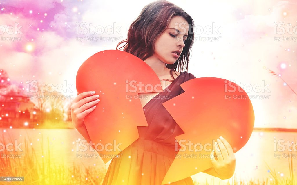 The sad woman with the broken heart stock photo