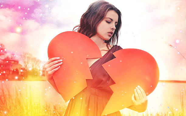 The sad woman with the broken heart bildbanksfoto